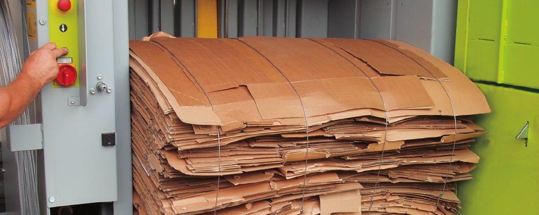 Baled cardboard inside waste baler
